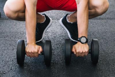 Musculation avec un coach sportif